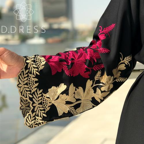 detail manches abaya Dubai brodee or fuchsia nidha nidah